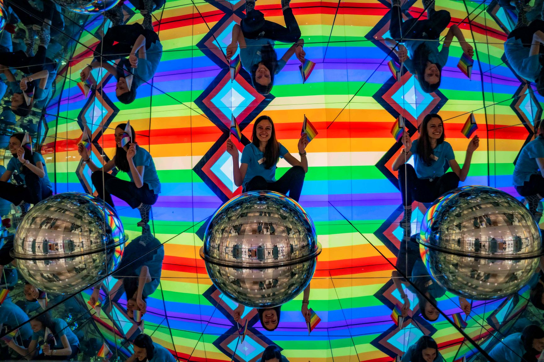 Team member Lisa in the Giant Kaleidosphere surrounded by the Progress Flag