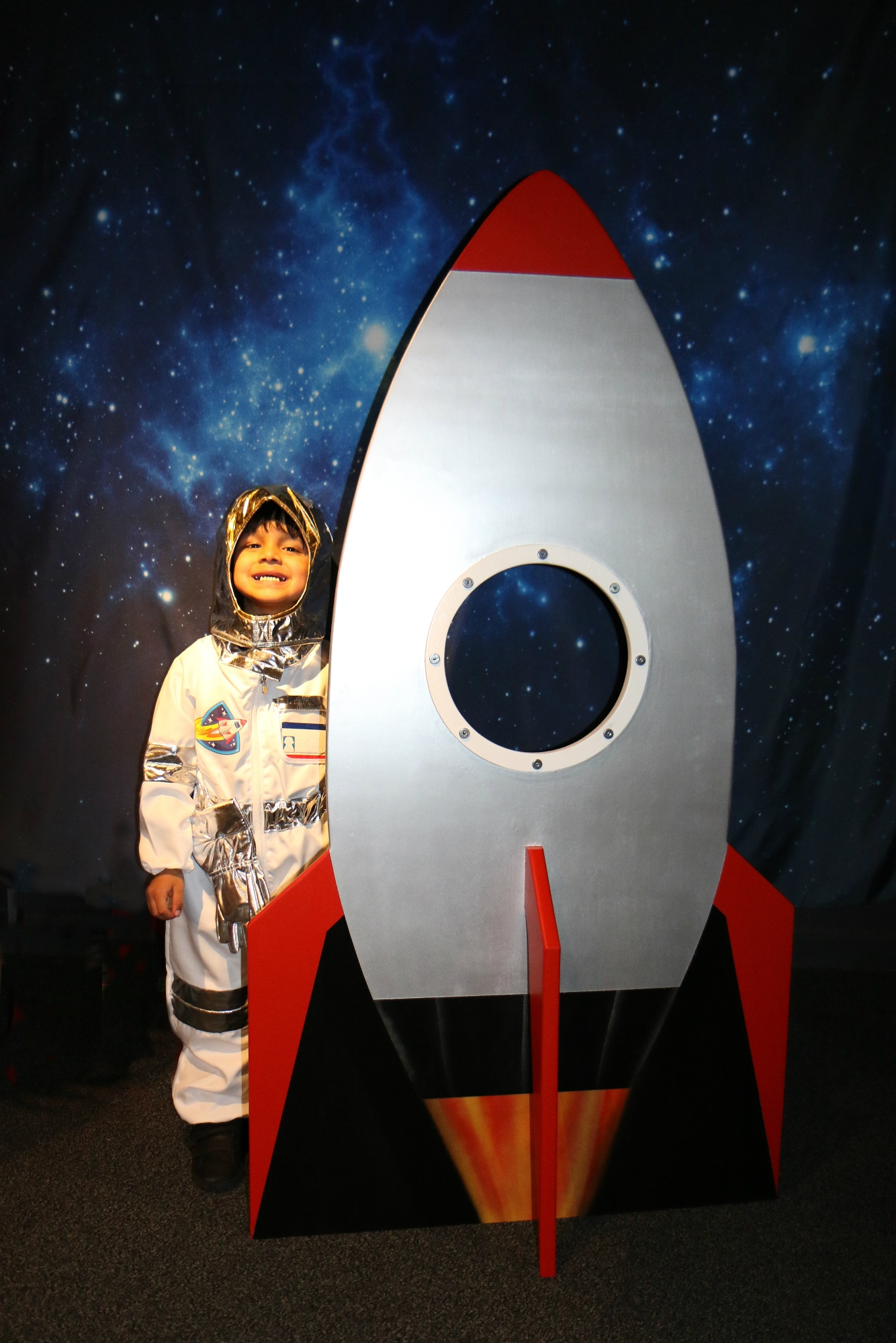 Toddler spaceman with rocket ship for Teeny Tiny Toddler Fest 2019.