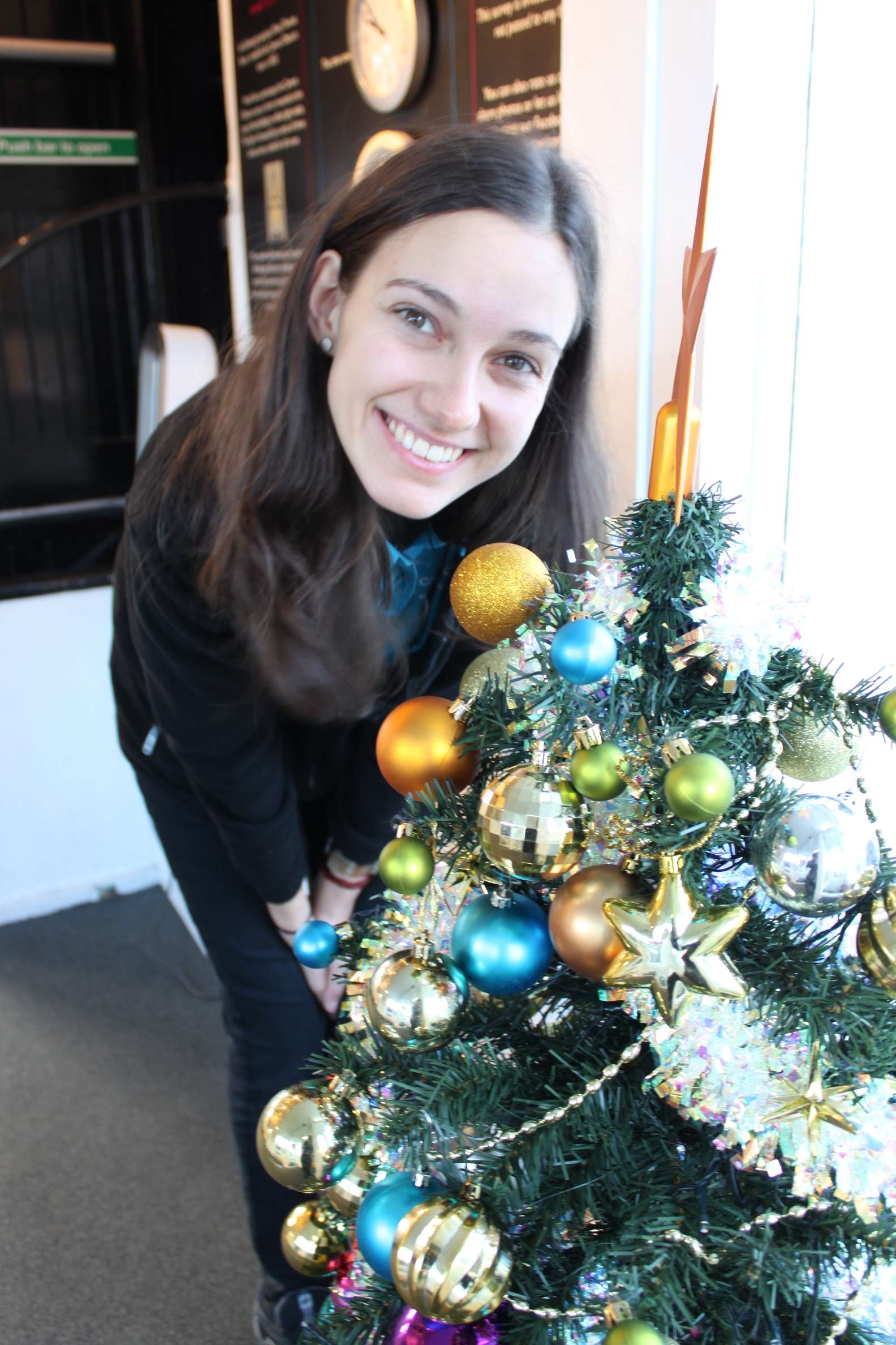 Lisa with Christmas tree, at Rooftop Terrace