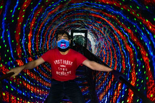 Visitor in Vortex Tunnel with face mask