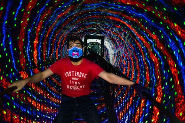 Visitor in the Vortex Tunnel at Camera Obscura